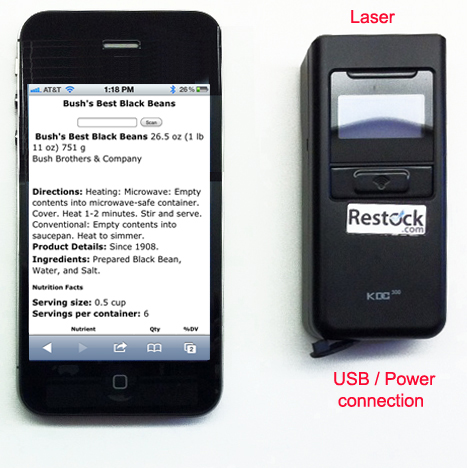 KDC300 laser scanner shown with an iPhone.   The connector end of the KDC300 is pointing to the bottom of the image